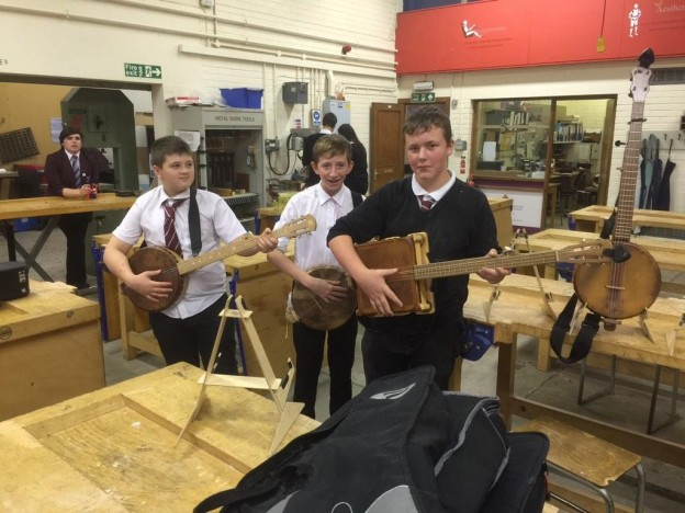 Forfar Academy Pupils trying out a few banjos. Photo by Mr Baldie.