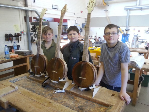 Scott Nicoll, Daniel Gough and Robbie Ferguson with their completed banjos.